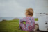 Photograph of toddler watching her sister play near the Wollongong Lighthouse on the South Coast of NSW