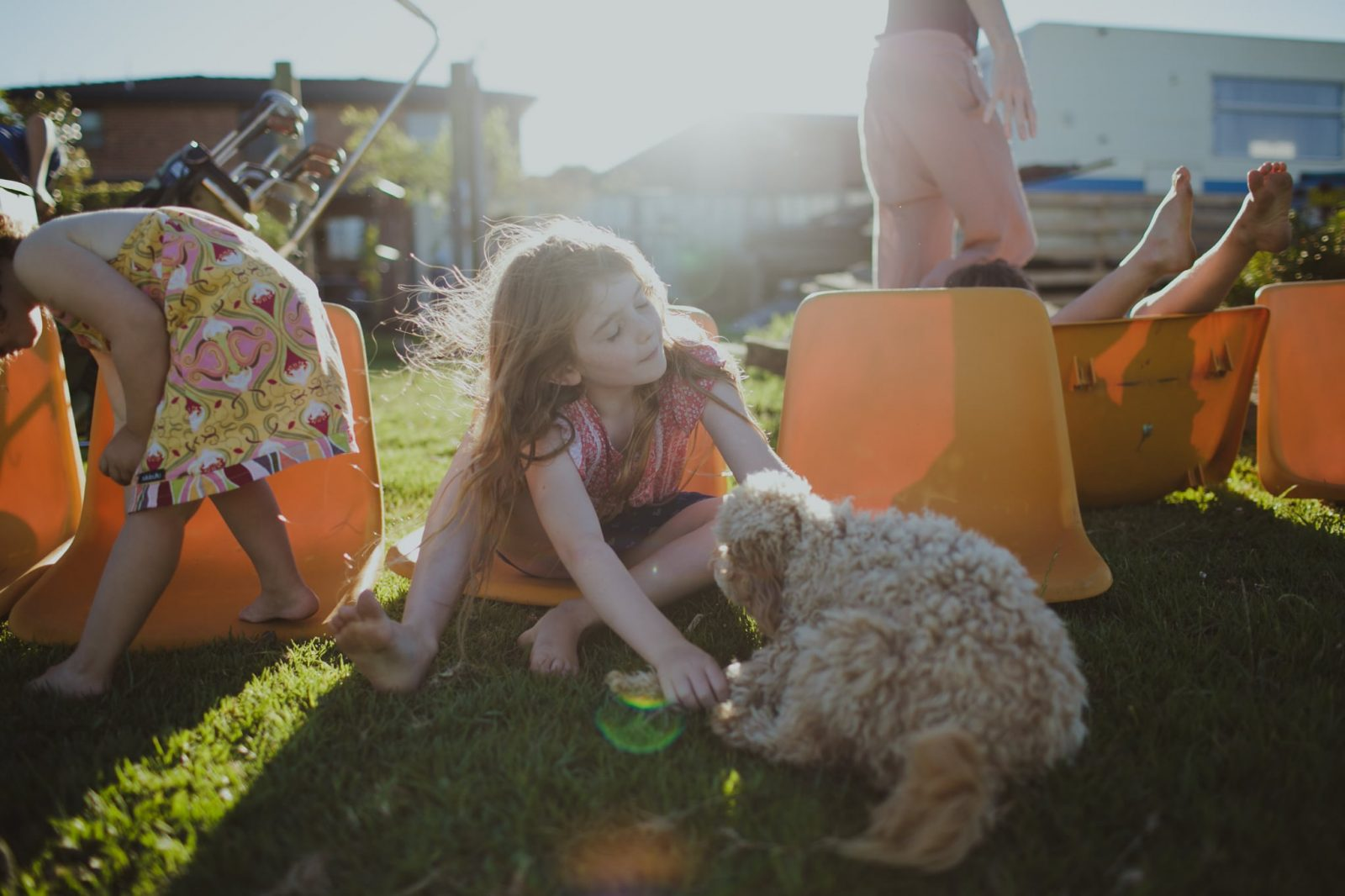 Photograph of siblings playing at home at dusk in Nowra during home documentary session on the South Coast of NSW