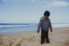 Photograph of young boy after walking in the ocean with his clothes on at Fairy Meadow on the South Coast of NSW