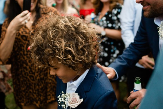 bride and grooms son walks down the aisle at soul of gerringong