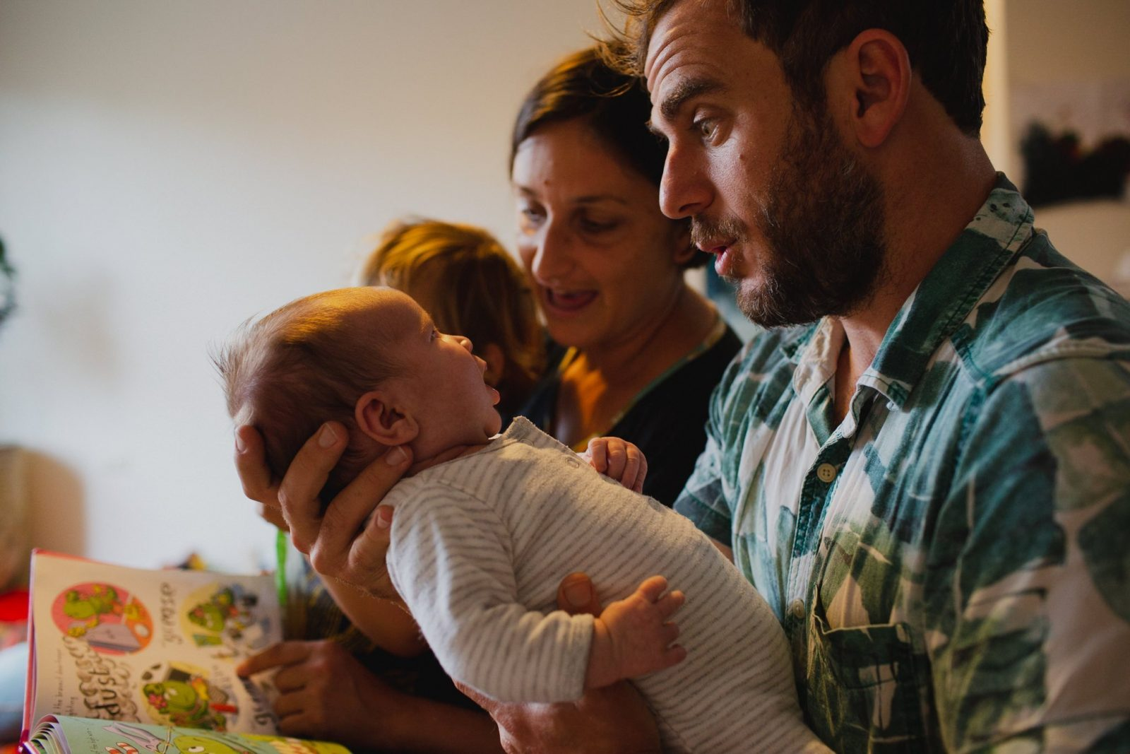 photograph of family with new baby at home in thirroul