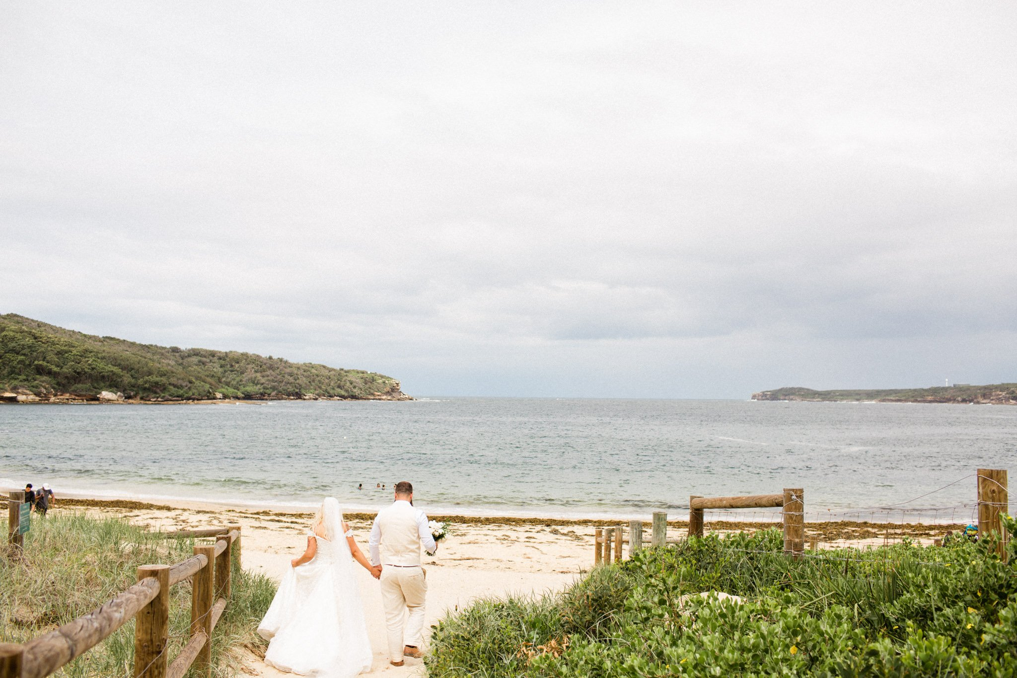Photograph of couple at the beach in NSW after wedding