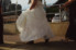 photograph of bride wearing cowgirl boots for her wedding day