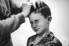 photograph of brides son getting his hair done before wedding ceremony in Dapto NSW