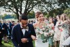 photograph of couple walking up aisle at wedding in southern highlands