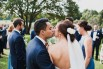 photograph of couple's sneaky kiss at wedding in southern highlands