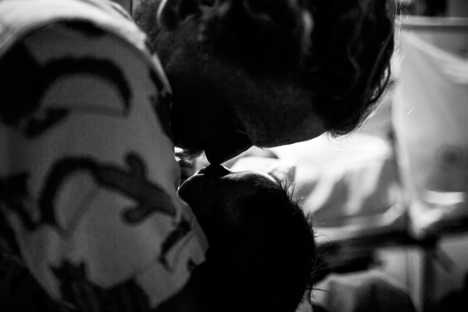 Photograph of uncle cuddling nephew on the day he was born at hospital in Wollongong NSW