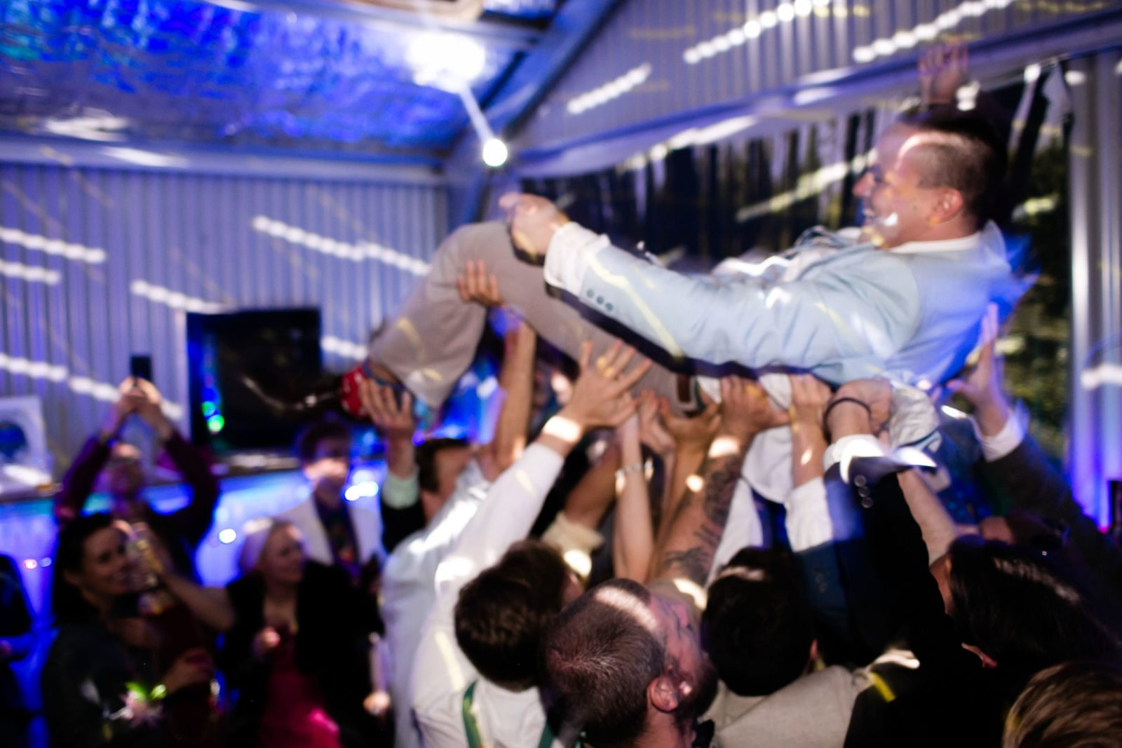 photograph of birthday boy crowd surfing at his prom night themed 30th in Wollongong NSW