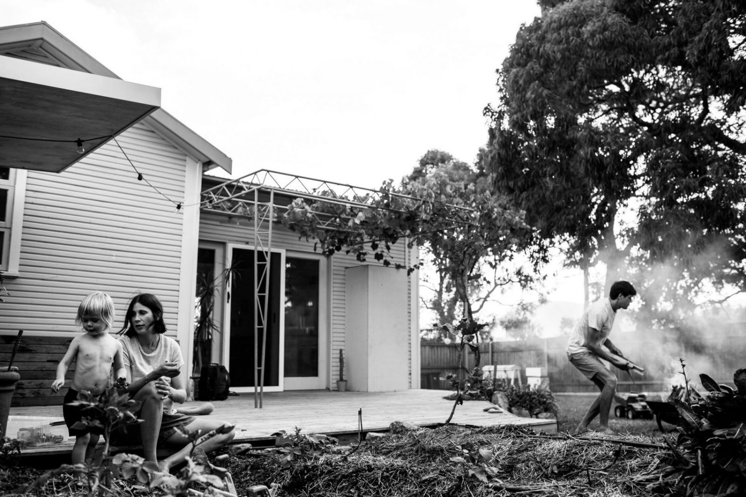 photograph of young family in their garden at home in wollongong