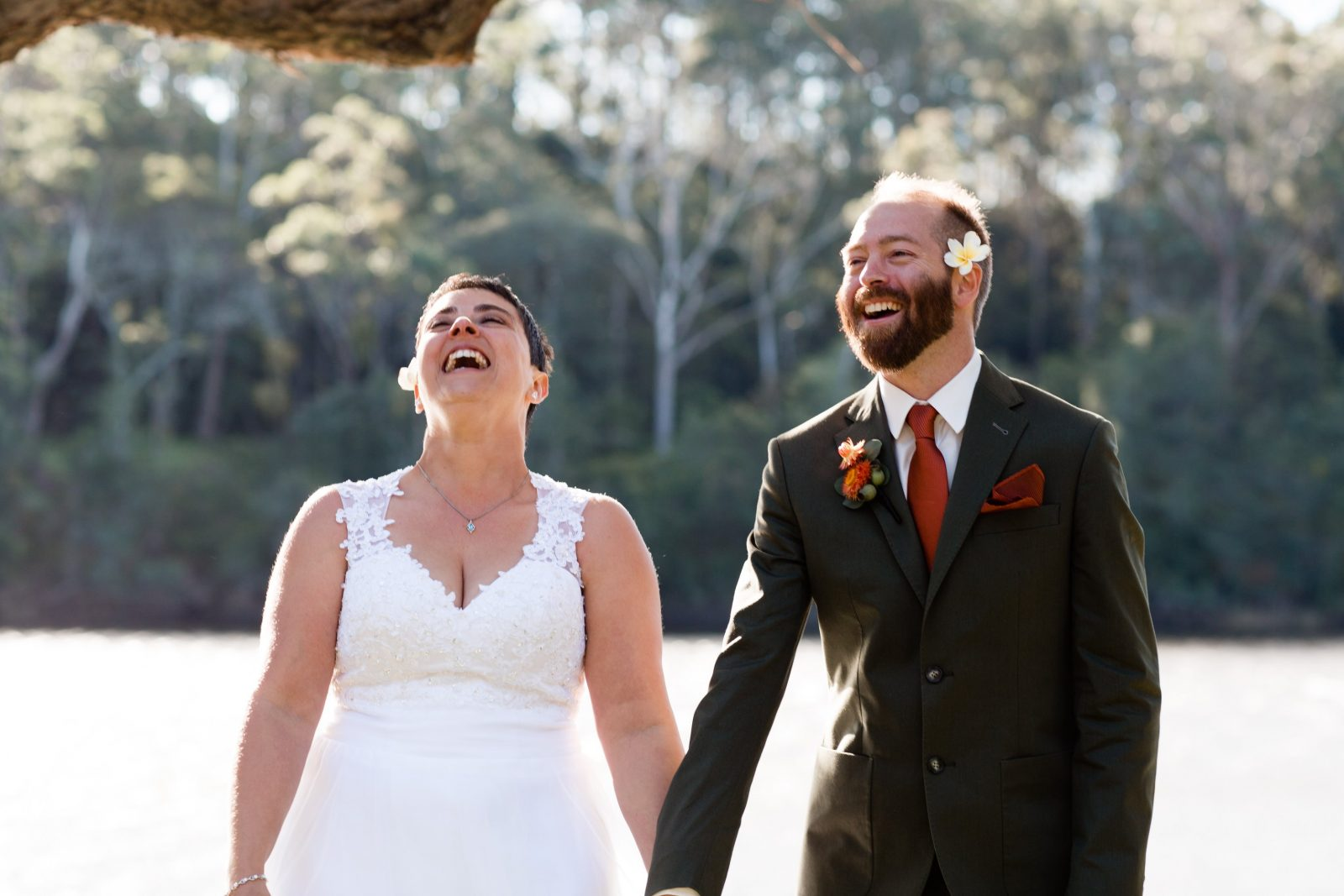 photograph of bride and groom laughing during their wedding ceremony at Bamarang Bush Retreat